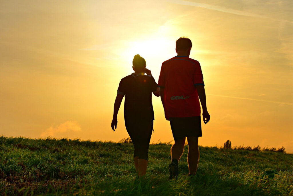 Spending quality time together like this couple walking through a field is a simple relationship goals