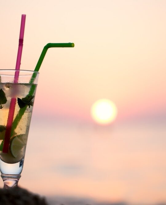Mojito mocktail on the beach at sunset