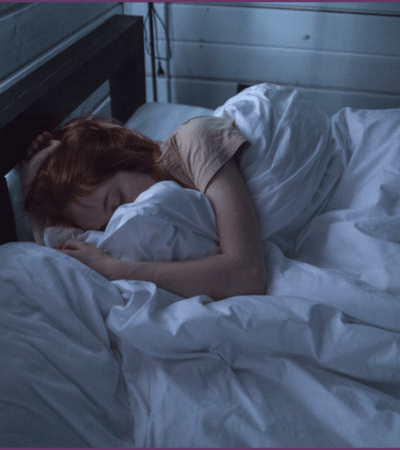 a woman getting the benefit s of sleep in bed