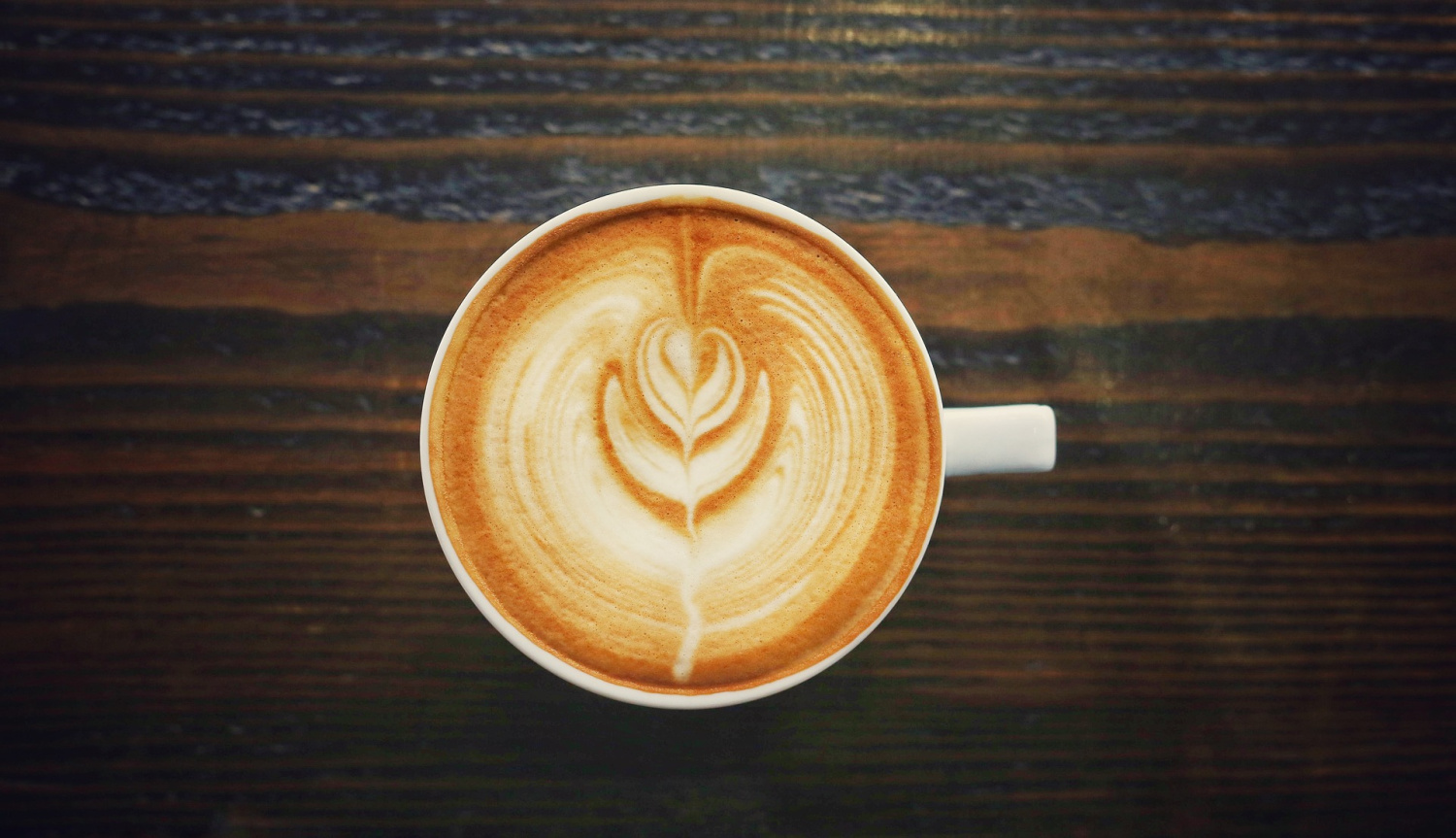 overhead view of latte in a mug