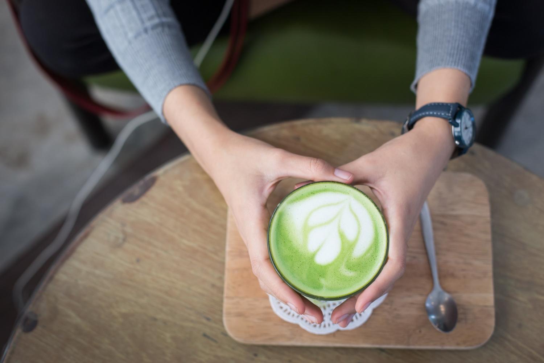 a mug filled with a latte made with matcha tea