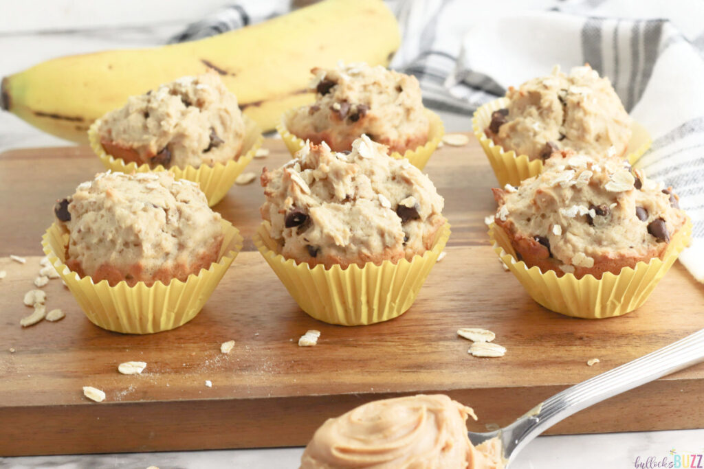 peanut butter banana chocolate chip muffins on cutting board
