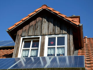 solor panels on a roof are one way to power your home for less