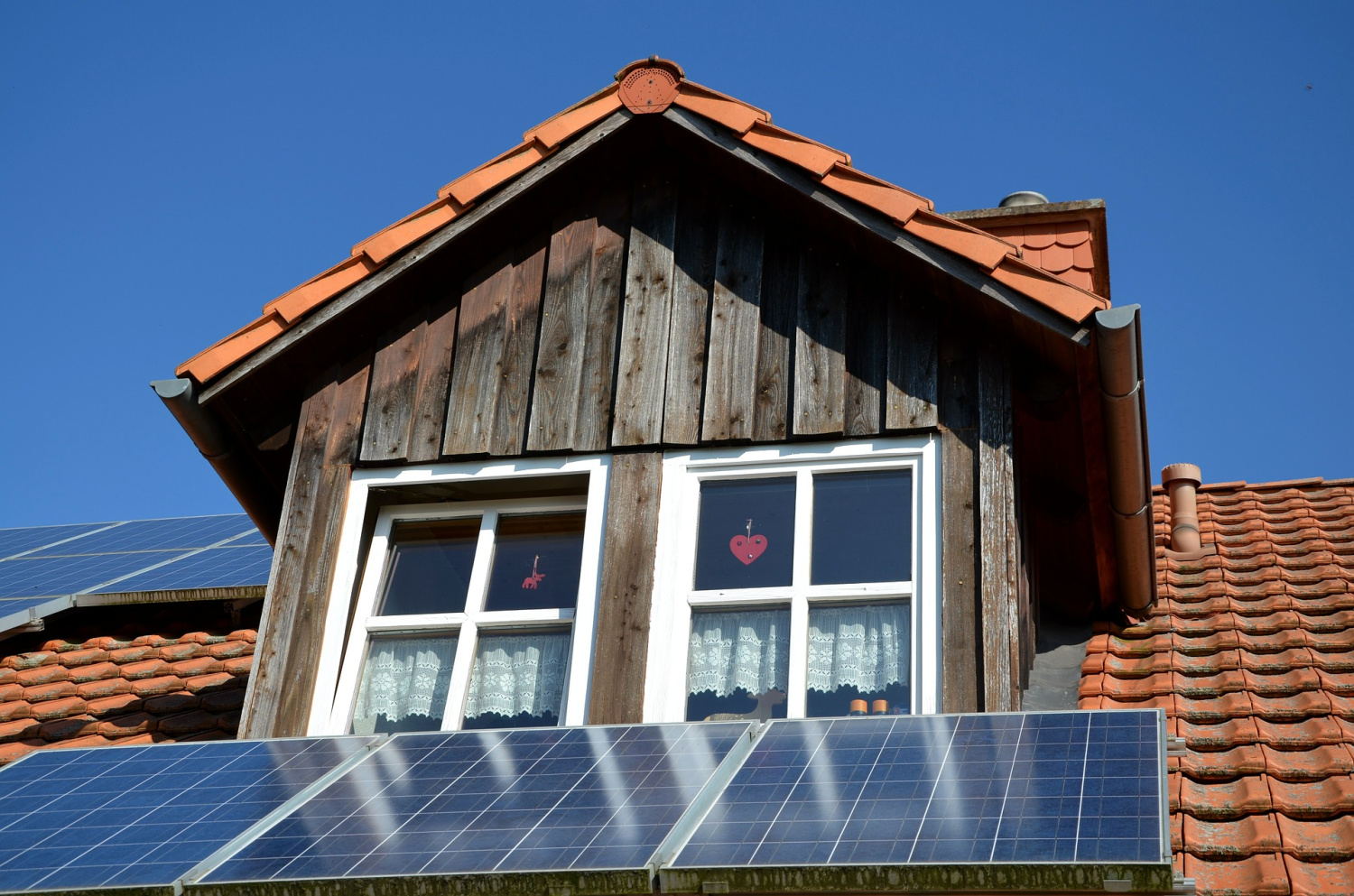 solar panels on a roof are one of the ways to power your home for less
