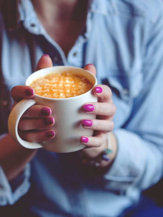 woman holding a mug of one of the most popular espresso drinks called lattelatte