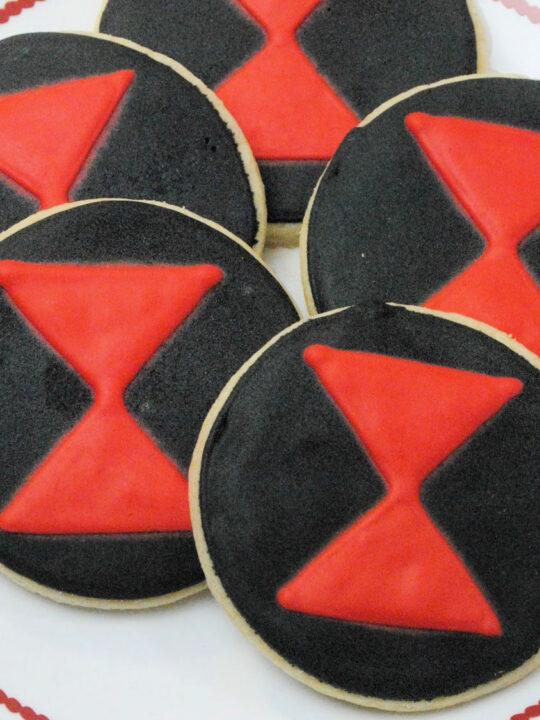 black widow cookies on white plate