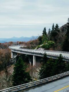 road winding through mountains is perfect for these traveling tips