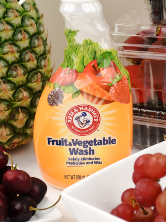 Arm & Hammer Fruit and vegetable Wash with fruit in a bowl