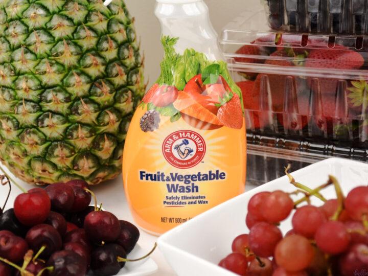 Arm & Hammer Fruit and Vegetable Wash bottle in front of fruit