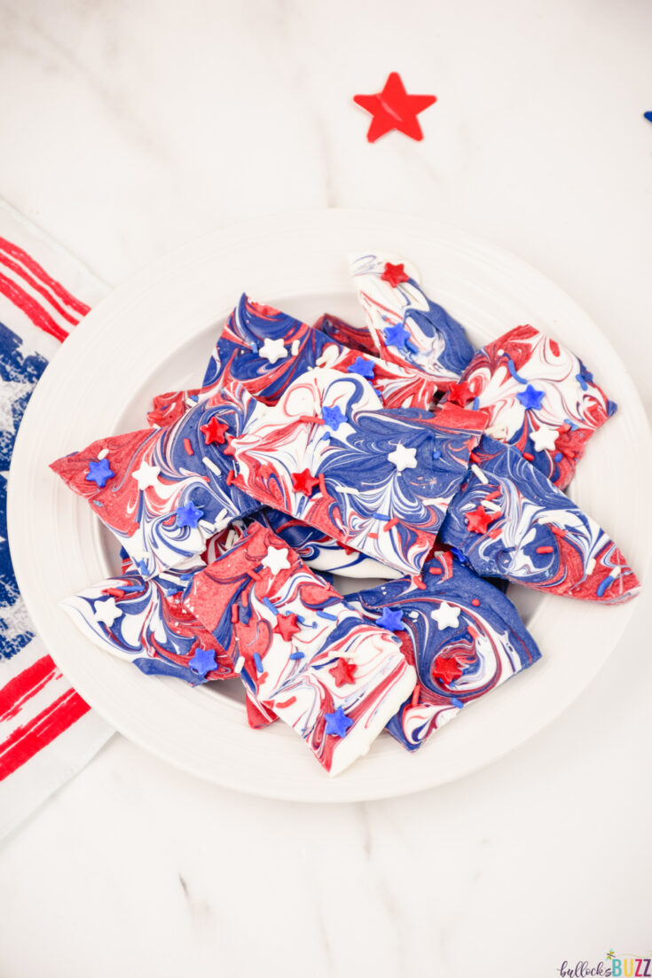 This easy homemade Patriotic candy bark makes a great red, white, and blue themed dessert. It's no-bake, so it comes together quickly. It has everything you could want in a 4th of July dessert: sweetness, pretty color, and pride! #4thofJuly #candybark #candy #recipe #candyrecipe