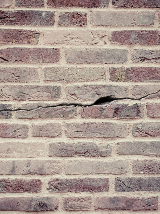repair services available for foundation damage like this cracked wall