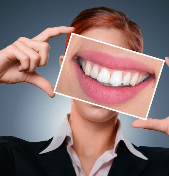 crowns and veneers can each help you get a beautiful smile like this one