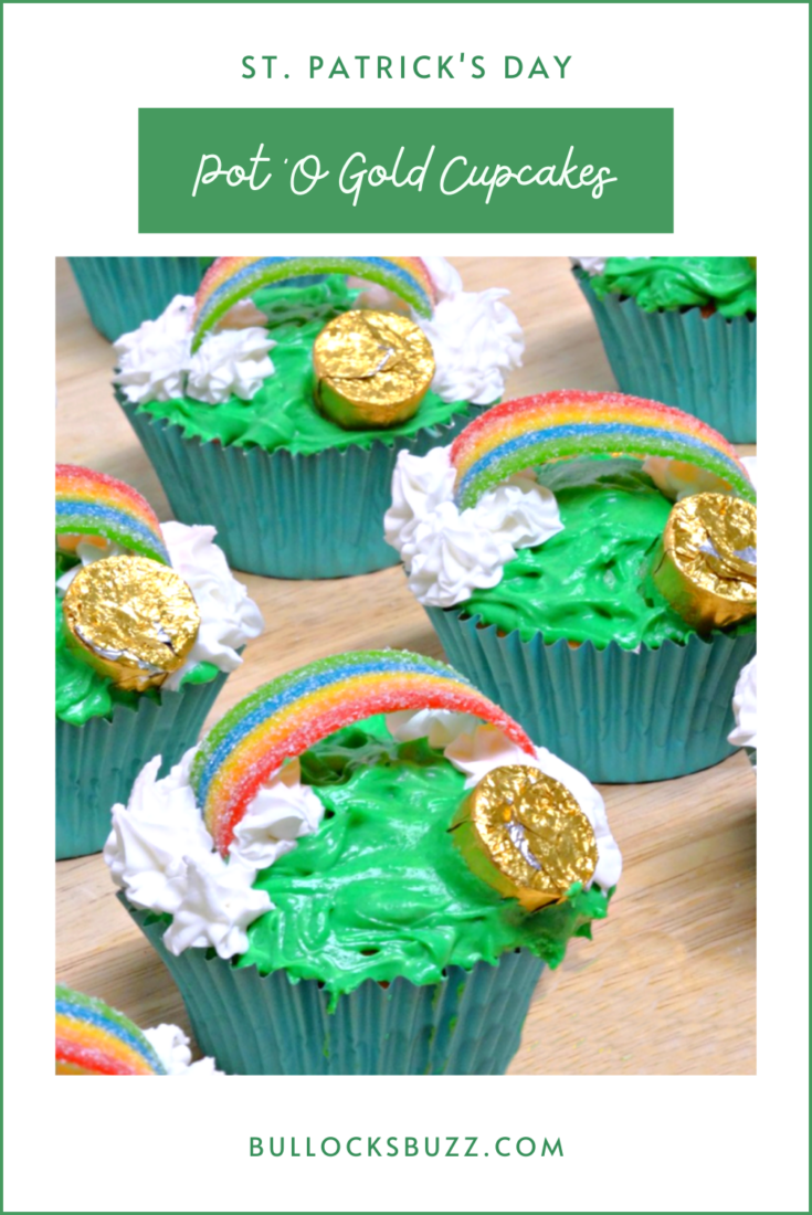 Liven up your St. Patty's celebration with these delicious vanilla cupcakes that are baked to golden perfection then decorated with clouds, a rainbow, and a pot of gold in this fun and tasty St. Patrick's Day Pot O' Gold Cupcakes recipe. #recipes #StPatricksDay