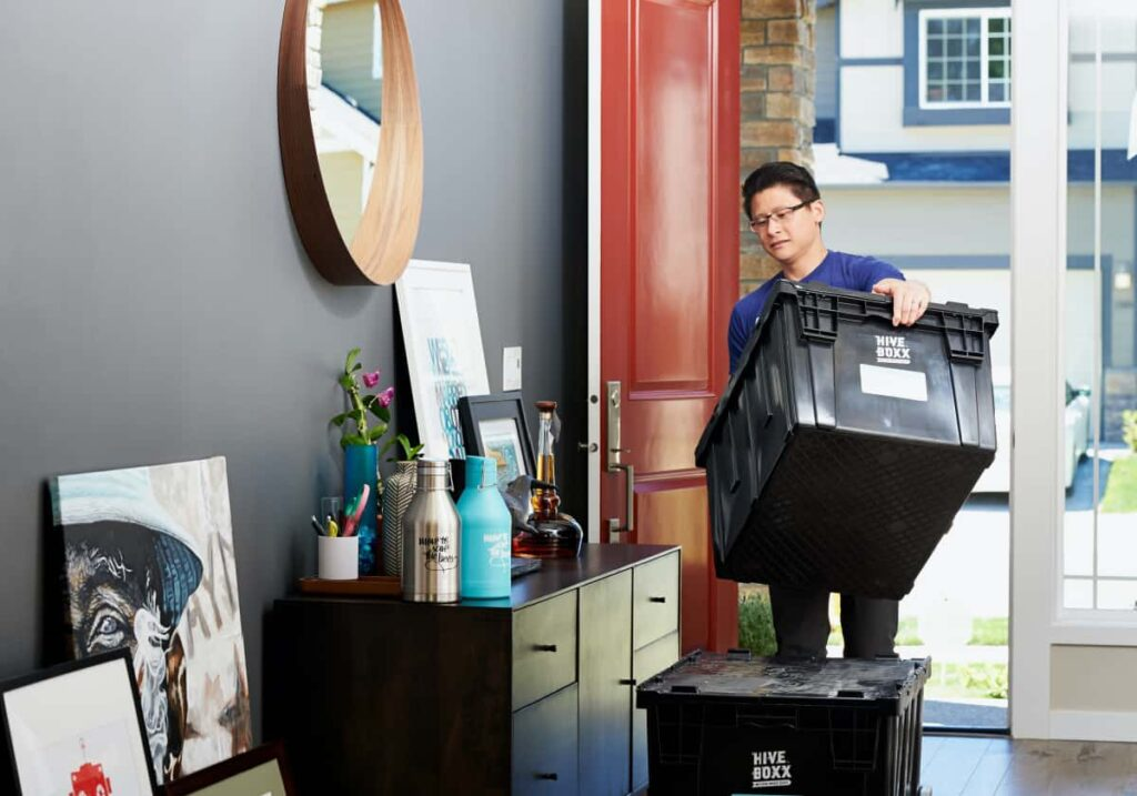 man packing because he is starting a new job in a new city