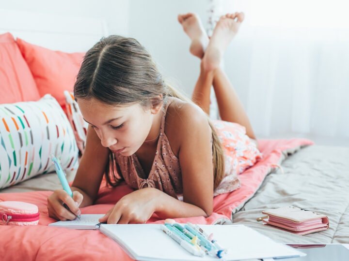 a child journaling as one of the 5 Crafts for Kids That Allow Self Expression