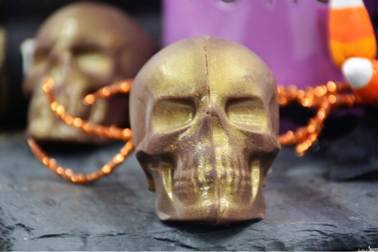 close up of gold skull hot cocoa bombs for Halloween