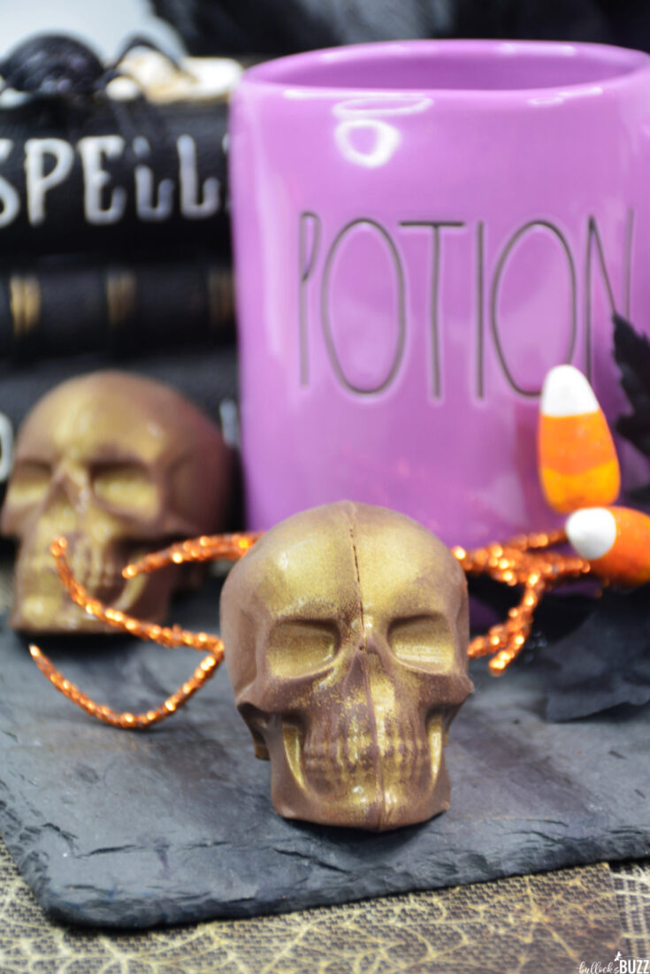 two gold Skull-Shaped Halloween Hot Chocolate Bombs