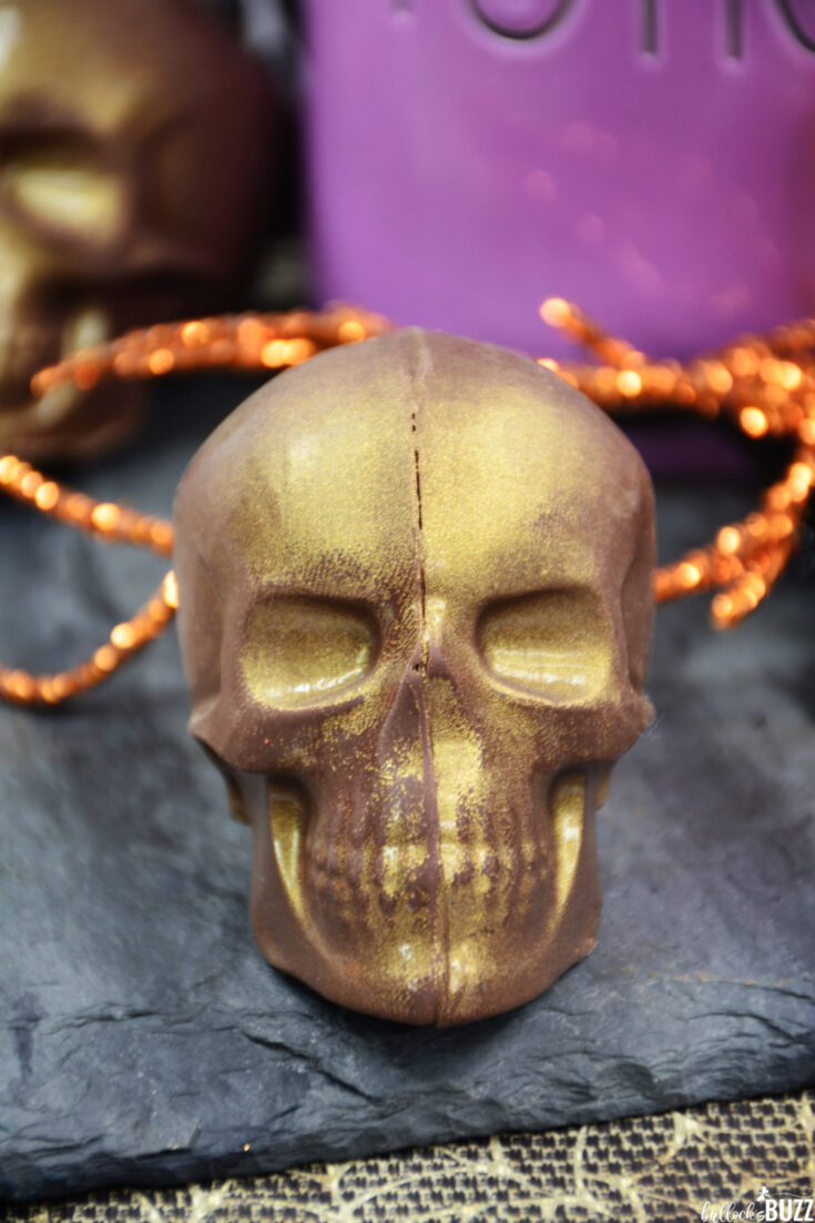 close up of gold Skull-Shaped Halloween Hot Cocoa Bomb