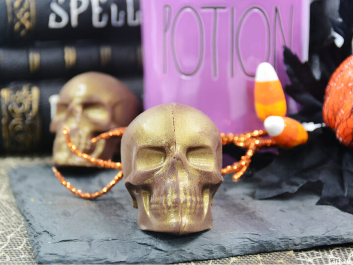 two Skull-Shaped Halloween Hot Cocoa Bombs sitting on a table