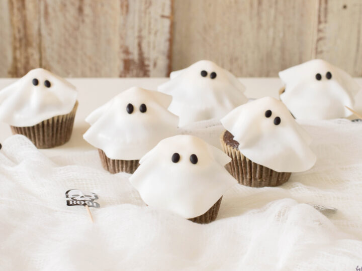 Halloween ghost cupcakes on table