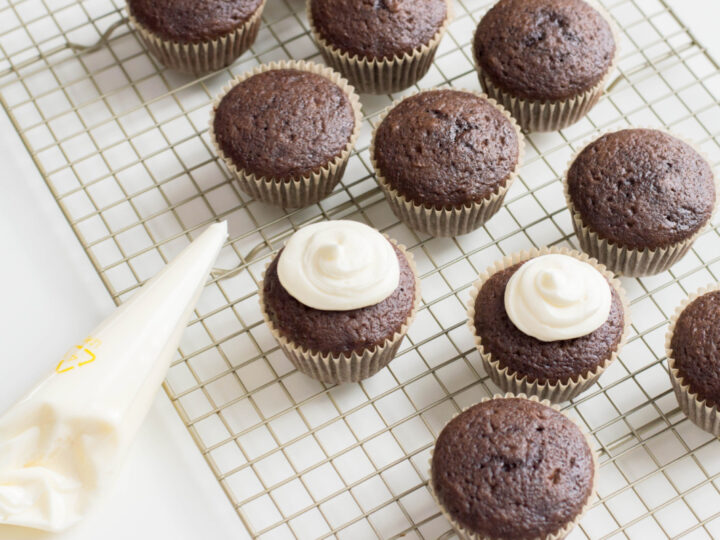 add dollop of frosting to baked cupcakes